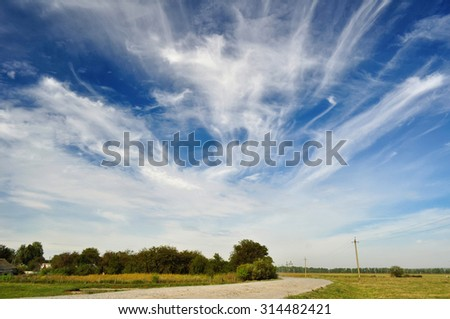 blue sky with clouds over the road - stock photo