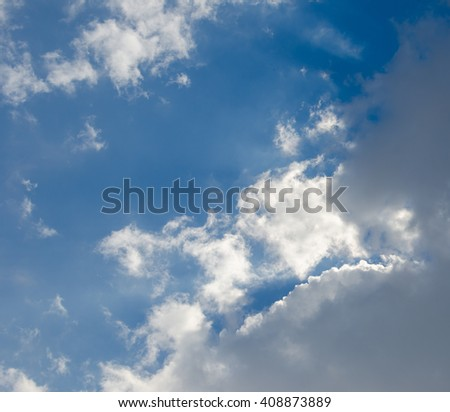 Blue sky with clouds. Sunny day with blue skies.