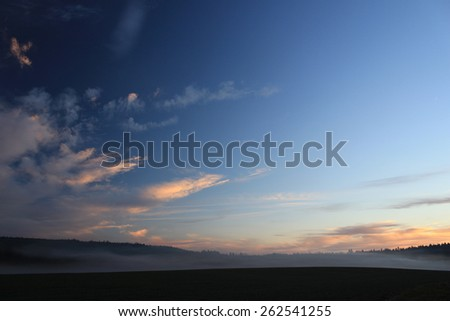 Blue sky with clouds sunset, for backgrounds or textures - stock photo