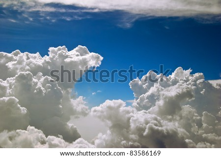 Blue sky with clouds. View from from airplane - stock photo