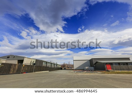 Blue sky with dramatic cloud over the factory at Twizel town, Mackenzie District in the Canterbury Region of New Zealand's South Island