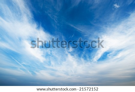Blue sky with fluffy clouds - stock photo