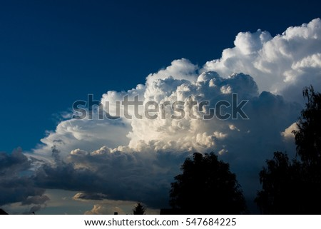 Blue sky with fluffy clouds close, dark clouds in blue sky whit storm.