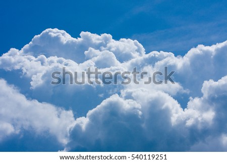 Blue sky with fluffy clouds close, soft white clouds in blue sky
