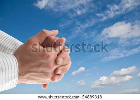blue sky with isolated praying hands