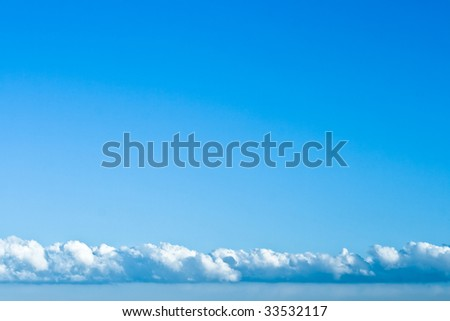Blue sky with layer of clouds