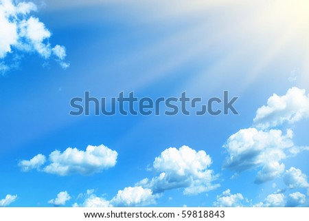 Blue sky with rays of light. - stock photo
