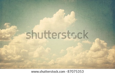Blue sky with some white puffy clouds - stock photo