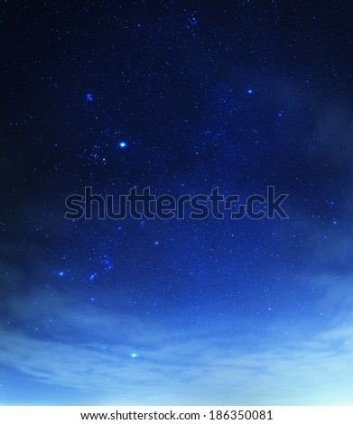 Blue sky with stars and thin clouds - stock photo