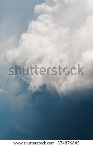 Blue Sky with Stormy Cumulus Clouds. Majestic Background. Selective Focus. - stock photo
