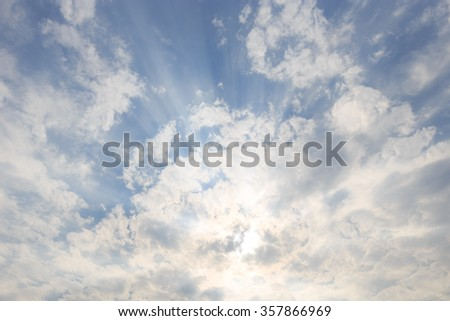 blue sky with sunbeams and clouds. Sun rays. - stock photo