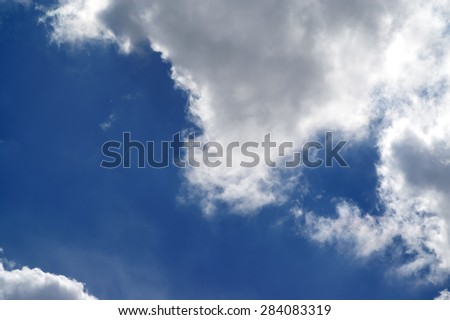 Blue sky with sunlight clouds  - stock photo