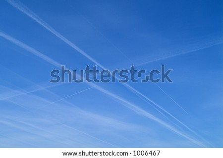 blue sky with traces of airplane