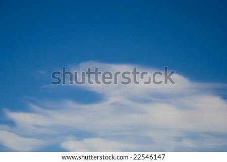 Blue sky with whispy cirrus clouds and copy space. - stock photo