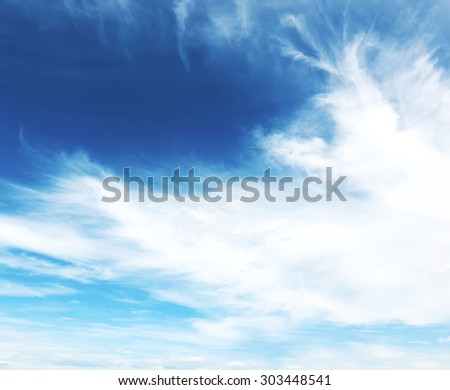 Blue sky with white and grey clouds - stock photo