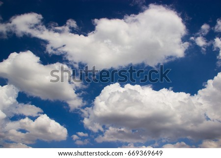 Blue sky with white cloud background. Sky can be used to decorate other images.