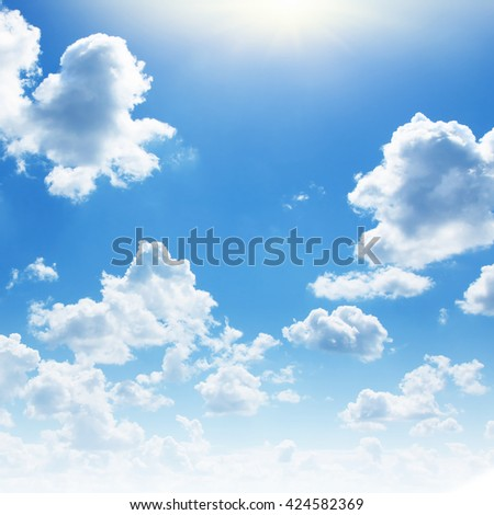 Blue sky with white clouds and sun. - stock photo