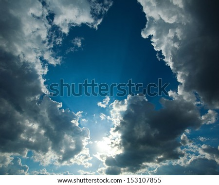 Blue sky with white clouds and sunshine - stock photo