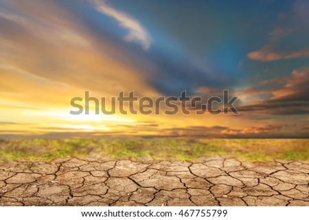Blue sky with white clouds before sunset and dry soil