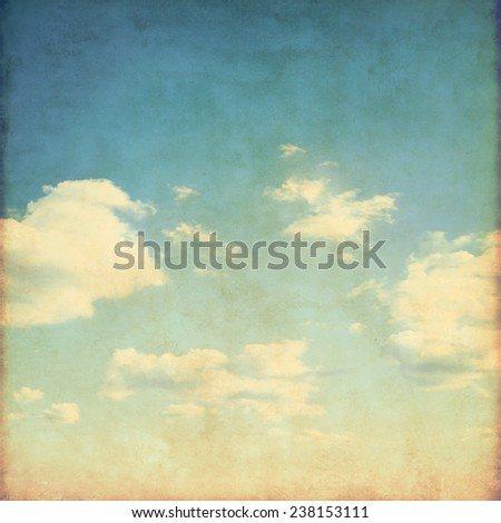 Blue sky with white clouds in grunge and retro style.