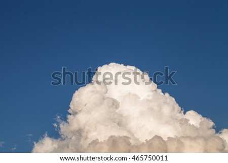 Blue sky with white clouds like a mountain.