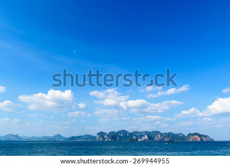Blue sky with white clouds over the ocean and islands at Krabi, Thailand - stock photo