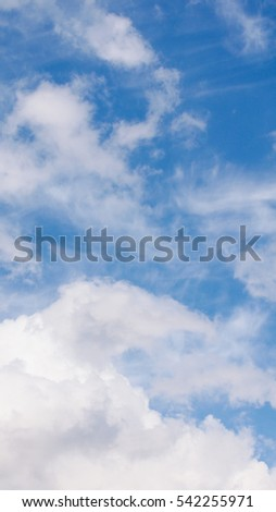 Blue sky with white clouds useful as a background