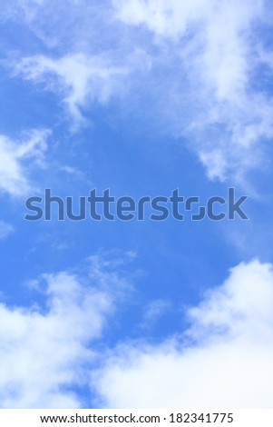 Blue sky with white clouds, vertical  background - stock photo