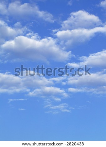 Blue sky with white clouds - vertical image - stock photo