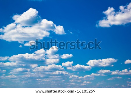 Blue sky with white clouds. Vivid colors.
