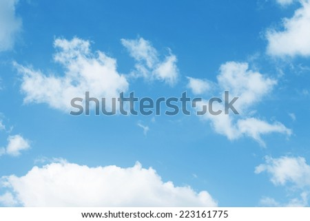 blue sky with white fluffy clouds in sunny summer day - stock photo