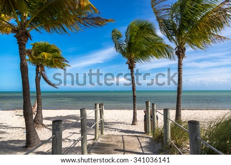 Blue sky with white sand and palm beach in Key West, USA - stock photo