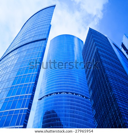 Blue skyscrapers heads in business centre - stock photo
