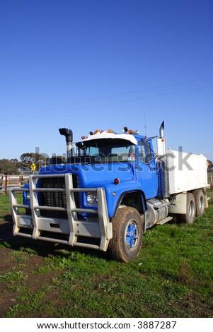 Blue small truck - stock photo