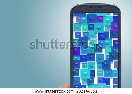 Blue smartphone and hear shapes. Idea for Valentines Day messages, love, lovers, love apps, Internet, blogs and others. - stock photo