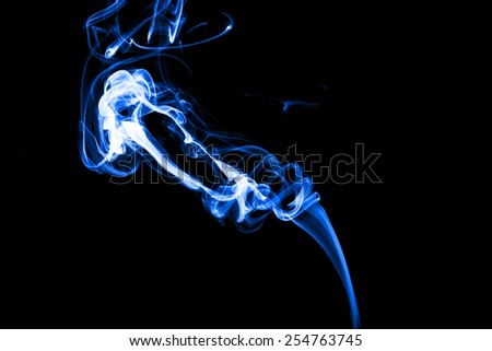 Blue smoke isolated with light on back background