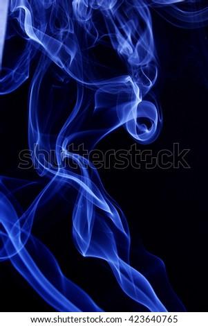 Blue smoke pattern against black background - stock photo
