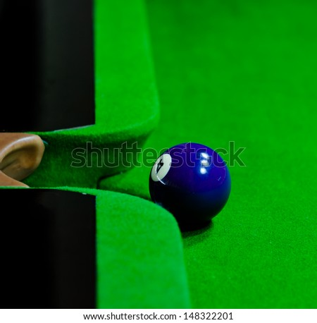 Blue snooker ball over green background - stock photo