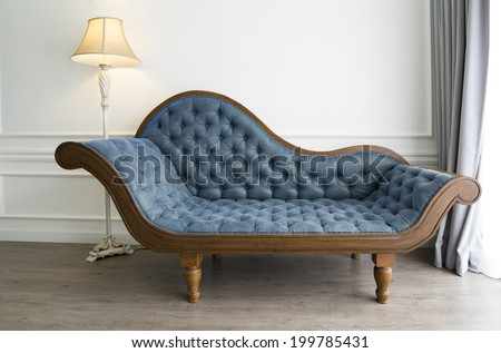 Blue sofa with luxurious look - stock photo