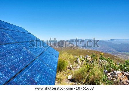 Blue solar batter cells and awesome mountain landscape as a background. Shot in Salmonsdam Nature Reserve, near Hermanus/Stanford, Western Cape, South Africa. - stock photo