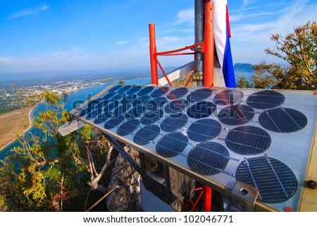 Blue solar batter cells and awesome mountain seascape as a background. Phajoupkirikun Gulf, Thailand - stock photo