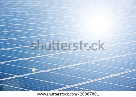 blue solar panel with sun reflection - stock photo