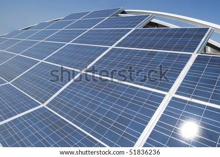 Blue solar panels arrangement - stock photo