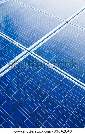 Blue solar panels pattern for sustainable energy - stock photo