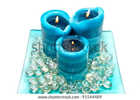 Blue spa candles isolated on white