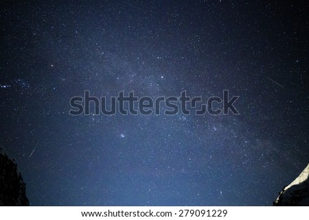 Blue space background with stars and shooting stars - stock photo