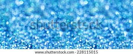 Blue sparkles, panorama. - stock photo