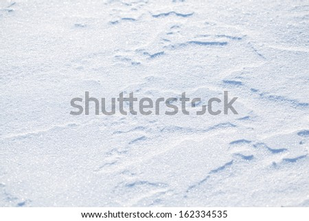 Blue sparkling snow background with white little snowflakes. - stock photo