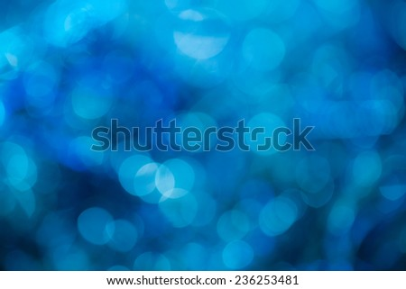 Blue special occasions background. Abstract with bright twinkles, sparkles, blurred, defocused light. - stock photo