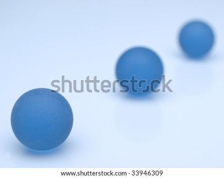 blue spheres aligned. Macro of blue glass marbles. - stock photo